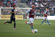Stephen Ireland of Aston Villa brings the ball upfield during a match between Aston Villa FC and Philadelphia Union at PPL Park in Chester, Pennsylvania, USA on Wednesday July 18, 2012. (photo - Mat Boyle)