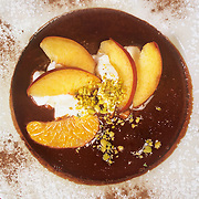 Dessert of peaches and oranges in a chocolate suace