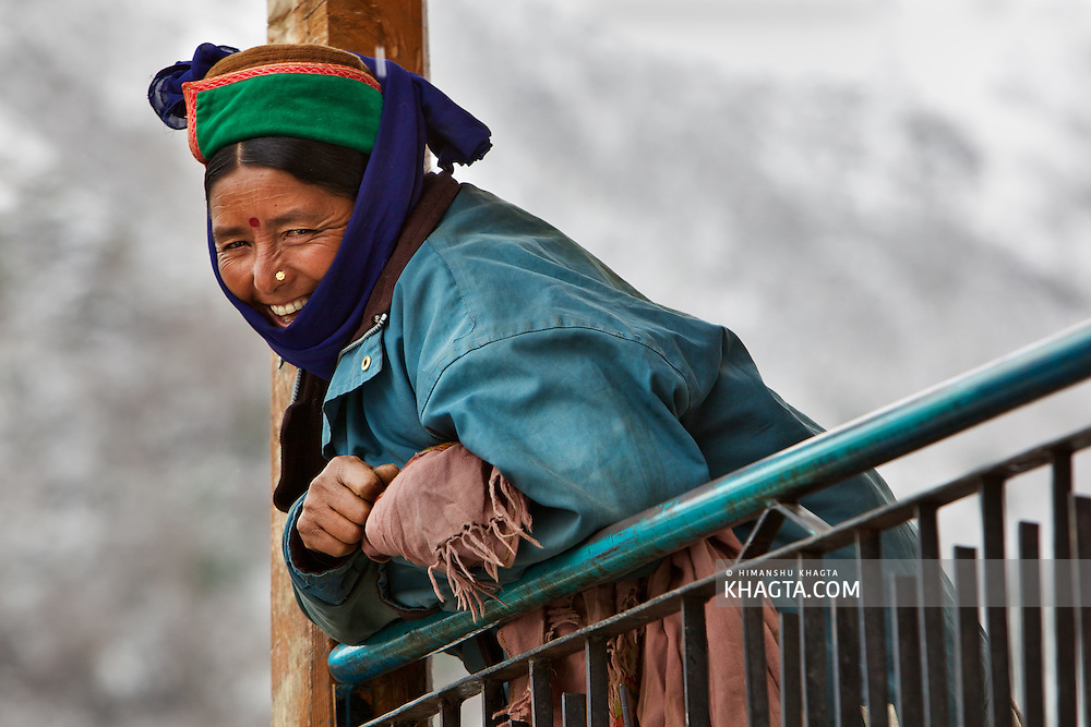 A Kinnauri Lady from the Himalayan Village of Chitkul, Kinnaur laughs while talking to her friend.
