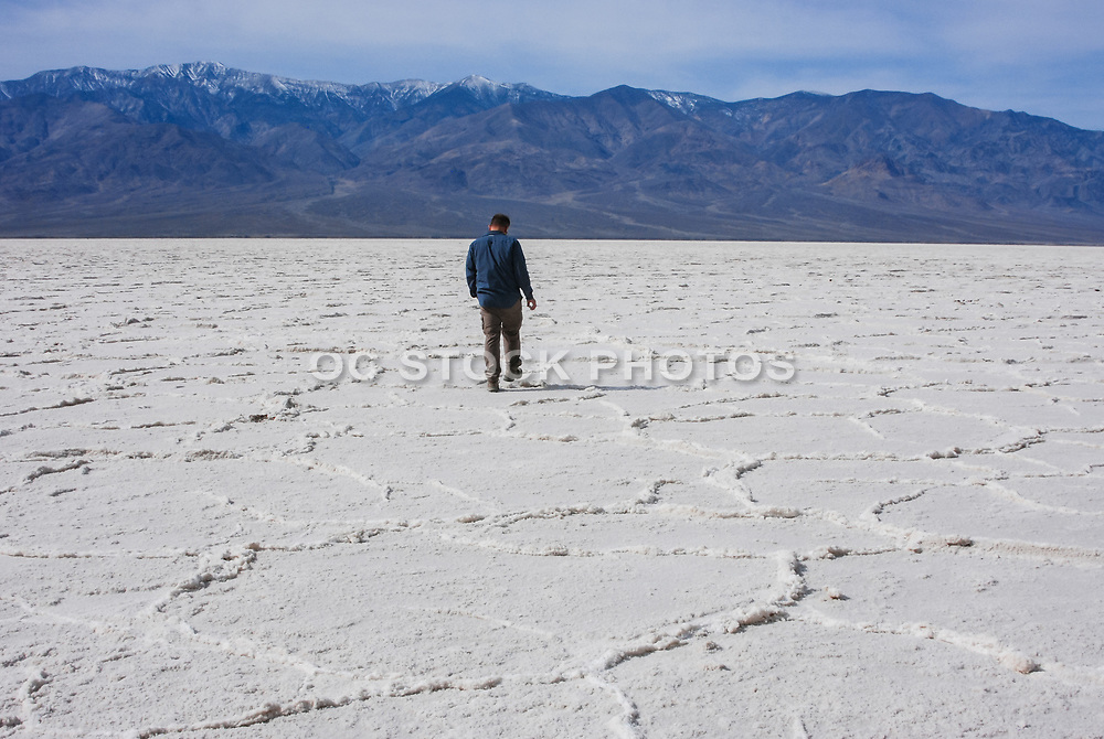Man Walking Across Death Valley Salt Flats