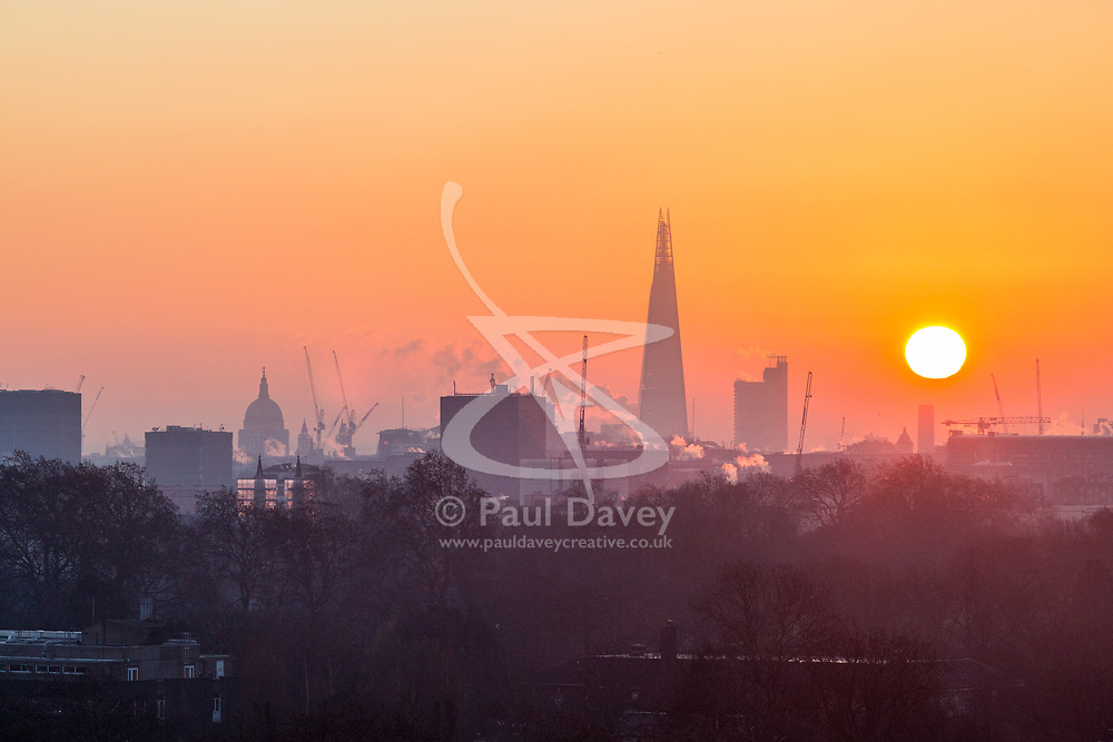 London, December 12 2017. Steam rises from buildings as the sun rises on a clear very cold morning in London, seen from Primrose Hill in Camden. © Paul Davey