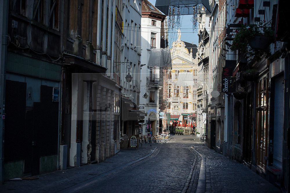 """© Licensed to London News Pictures. 23/11/2015. Brussels, Belgium. A deserted street in central Brussels, leading the The Grand Place, the main square in Brussels at 2pm. The city is currently on """"lockdown"""" amid """"imminent threat"""" of Paris-style bomb and gun attacks. Photo credit: Ben Cawthra/LNP"""