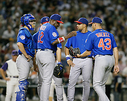Phoenix, AZ-04-26-04 Chicago Cubs manager Dusty Baker gives the ball to Michael Wuertz in the 5th inning, replacing starter Carlos Zambrano in a 9-0 loss to the Arizona Diamondbacks. Ross Mason photo