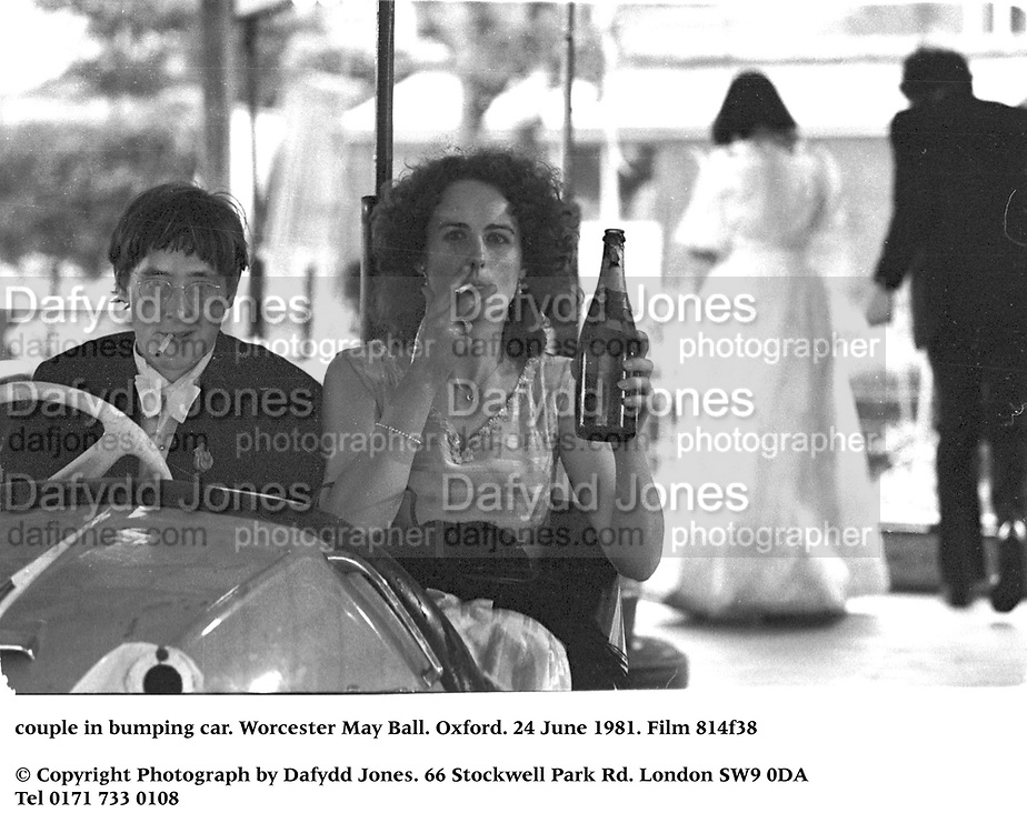 couple in bumping car. Worcester May Ball. Oxford. 24 June 1981. Film 814f38<br />© Copyright Photograph by Dafydd Jones<br />66 Stockwell Park Rd. London SW9 0DA<br />Tel 0171 733 0108