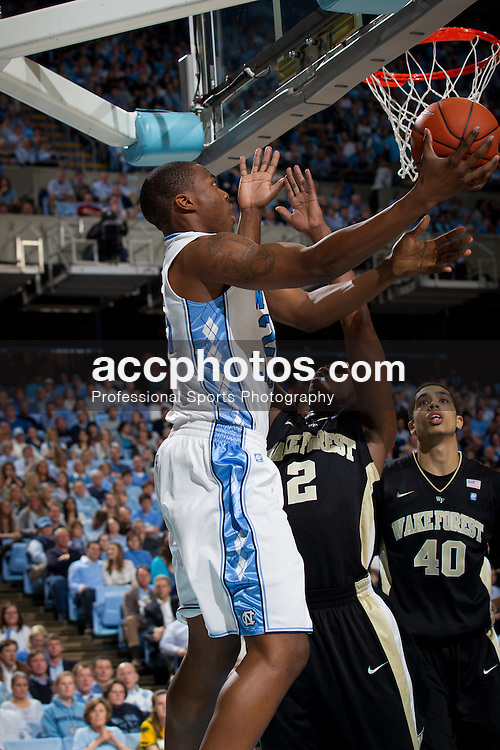 CHAPEL HILL, NC - FEBRUARY 15: Justin Knox #25 of the North Carolina Tar Heels scores over Gary Clark #2 of the Wake Forest Demon Deacons at the Dean E. Smith Center in Chapel Hill, North Carolina. North Carolina won 64-78. (Photo by Peyton Williams/UNC/Getty Images) *** Local Caption *** Justin Knox;Gary Clark