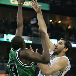 Hornets Peja Stojakovic #16 shoots over Bulls forward Luol Deng #9 in the second half of their NBA game on March 17, 2008 at the New Orleans Arena in New Orleans, Louisiana. The New Orleans Hornets defeated the Chicago Bulls 108-97.