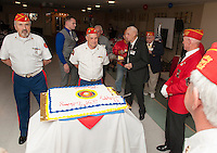 In tradition of the Marines 239th birthday Bob Pelland, Pete Romano, Commandant Robert Patenaude and David French serve a piece of cake to the oldest and youngest marines present.  Sgt Justin Kane as the youngest marine receives his piece of cake from World War II veterans Russell Cilly, Harold Sheffield, Frank Gorski and Roger Paris.   (Karen Bobotas/for the Laconia Daily Sun)
