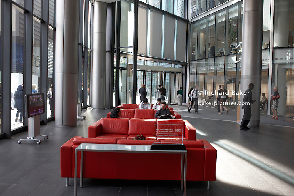 Busy main entrance of an auditing company's 385,000 square foot Norman Foster-designed London headquarters