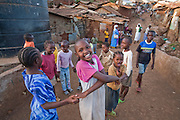 Kids playing on a street in the Kibera slum,  Africa's largest slum settlement where nearly a million people live in grinding poverty, with no access to running water and ablution facilities.
