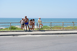 Sunbathers come up from the beach to see what all the fuss is about on Stage 8 of the Giro Rosa - a 141.8 km road race, between Baronissi and Centola fraz. Palinuro on July 7, 2017, in Salerno, Italy. (Photo by Sean Robinson/Velofocus.com)