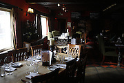Tables at The Durham Ox restaurant are ready for guests, in Crayke, Yorkshire, England, United Kingdom.