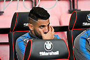 Riyad Mahrez (26) of Leicester City on the bench during the Premier League match between Bournemouth and Leicester City at the Vitality Stadium, Bournemouth, England on 30 September 2017. Photo by Graham Hunt.