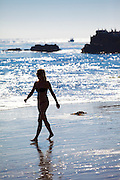 Silhouette of Woman Walking on Beach