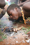 Africa, Tanzania, Lake Eyasi, Hadza men lighting a camp fire for cooking during a hunting expedition. Small tribe of hunter gatherers AKA Hadzabe Tribe April 2006