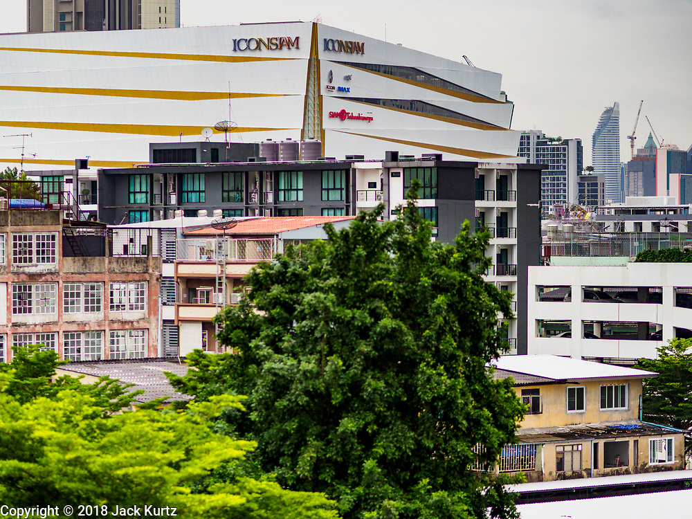 09 NOVEMBER 2018 - BANGKOK, THAILAND: The ICONSIAM development towers over the Thonburi section of Bangkok. ICONSIAM opened November 9. ICONSIAM is a mixed-use development on the Thonburi side of the Chao Phraya River. It includes two large malls, with more than 520,000 square meters of retail space, an amusement park, two residential towers and a riverside park. It is the first large scale high end development on the Thonburi side of the river and will feature the first Apple Store in Thailand and the first Takashimaya department store in Thailand.     PHOTO BY JACK KURTZ