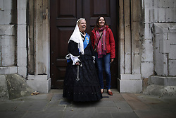 © Licensed to London News Pictures. 27/09/2015. London, UK. A woman dresses as Queen Victoria poses with a Russian tourist before taking part in a Harvest Festival celebration. Photo credit: Peter Macdiarmid/LNP