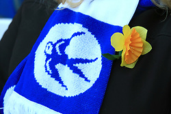 Cardiff City fans wear daffodils to honour missing footballer Emiliano Sala during the Premier League match at the Cardiff City Stadium.