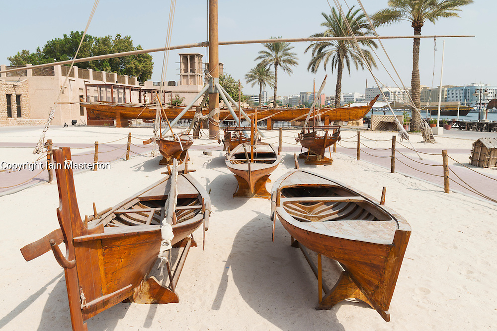 Traditional wooden boats on display at the Diving Village outdoor Museum in the  Heritage area at Al Shindagha in Dubai United Arab Emirates