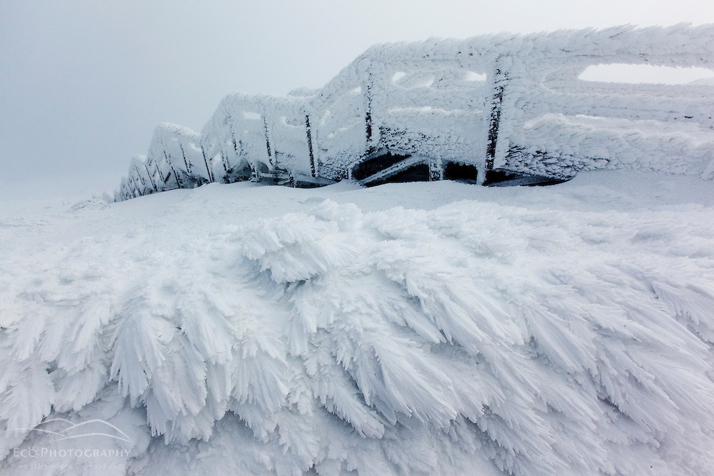 A staircase covered in rime ice on the summit of New Hampshire's Mount Washington in winter.