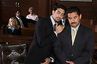 Two men sitting in court