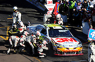 Nov. 15, 2009; Avondale, AZ, USA; NASCAR Sprint Cup Series driver Greg Biffle pits during the Checker O'Reilly Auto Parts 500 at Phoenix International Raceway. Mandatory Credit: Jennifer Stewart-US PRESSWIRE