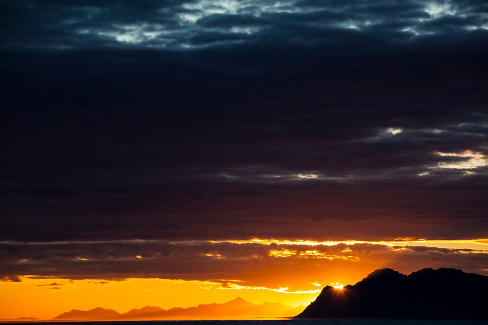 Sunset over mountains on the coast in Spitsbergen, Svalbard.