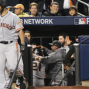 NEW YORK, NEW YORK - October 5: Conor Gillaspie #21 of the San Francisco Giants celebrates with team mates as he returns to the dugout after hitting a three run home run in the top of the ninth during the San Francisco Giants Vs New York Mets National League Wild Card game at Citi Field on October 5, 2016 in New York City. (Photo by Tim Clayton/Corbis via Getty Images)