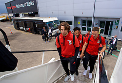 CARDIFF, WALES - Saturday, June 10, 2017: Wales' Joe Allen, captain Ashley Williams and James Chester board the team plane as the squad depart Cardiff Tesla Airport to travel to Belgrade ahead of the 2018 FIFA World Cup Qualifying Group D match against Serbia. (Pic by David Rawcliffe/Propaganda)