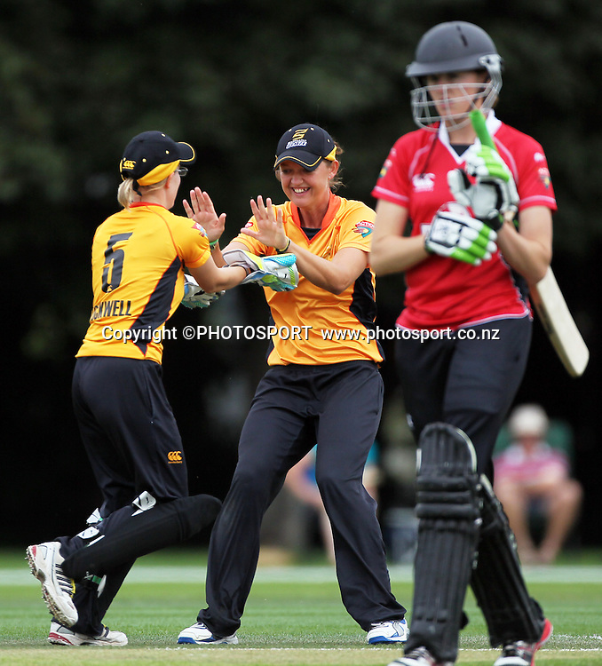 Wellington player Sarah Taylor congratulaes Andrea Stockwell after taking a good catch to dismiss Amy Satterthwaite. Canterbury Magicians v Wellington Blaze. Action Cricket Twenty20, womens cricket match, Lincoln No. 3, Lincoln University, Thursday 29 December 2011. Photo : Joseph Johnson / photosport.co.nz