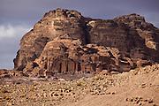 Tomb facades carved into a rock mountain in Petra, Jordan.