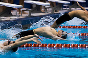 York Suburban's Karl Schmittle launches off the blocks for the Boys 200 Yard Medley Relay during a swim meet between the Gettysburg Warriors and York Suburban Trojans at Gettysburg College on Monday, Jan. 9, 2017. The Trojans defeated the Warriors 93-77. / Harrison Jones for GametimePA.com