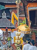 Women worshipping inside a temple near Tabanan in Bali, Indonesia