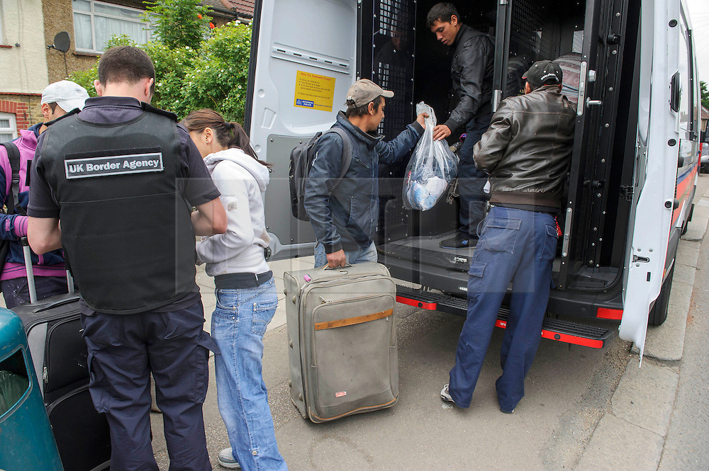&copy; Licensed to London News Pictures. 26/06/2013 London, UK. Romanian immigrants are driven to the airport  and served eviction papers after a dawn raid on Hendon Football Club, Hendon North West London. The 68 illegal immigrants were removed in a joint Home Office Immigration, Met Police and homeless charity operation after the site has been occupied for more than 2 years.<br /> Photo credit : Simon Jacobs/LNP