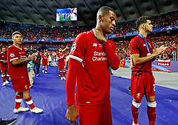 Giorgio Wijnadlum of Liverpool FC looks dejected after 3-1 loss against Real Madrid during the UEFA Champions League final between Real Madrid and Liverpool on May 26, 2018 at NSC Olimpiyskiy Stadium in Kyiv, Ukraine