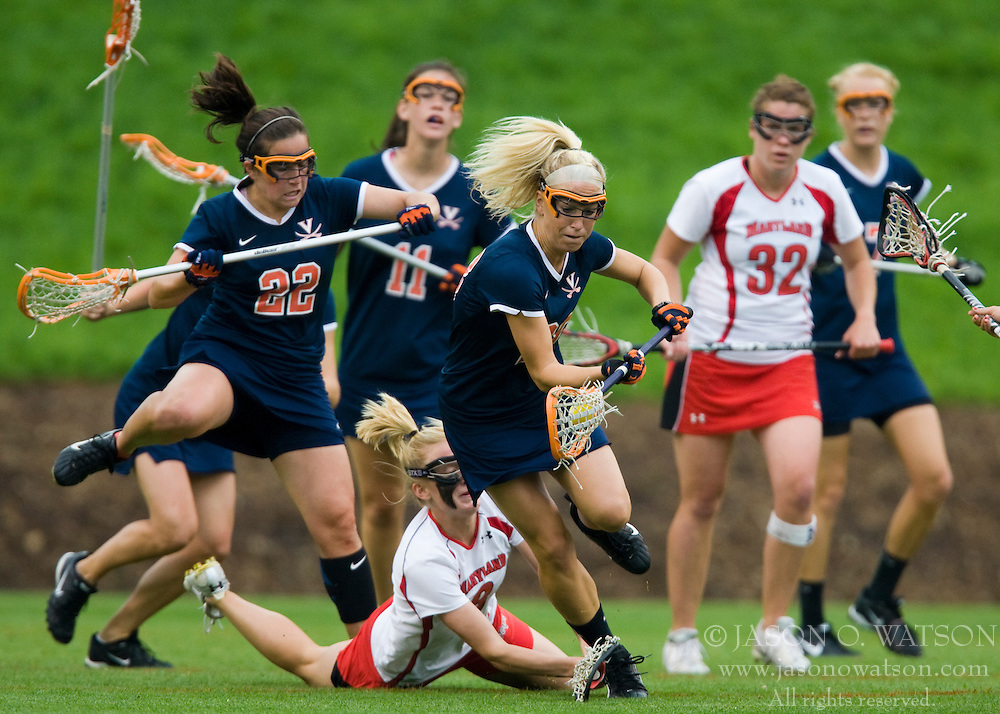 Virginia Cavaliers A Megan O'Malley (28) scoops up a loose ball.  The #3 ranked Virginia Cavaliers defeated the #2 ranked Maryland Terrapins 10-9 in overtime in the finals of the Women's 2008 Atlantic Coast Conference Lacrosse tournament at the University of Virginia's Scott Stadium in Charlottesville, VA on April 27, 2008.