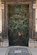 Figures on stunning bronze entry doors added to the Church of St. Nichoas in 1996 to commemorate  the visit of Pope John Paul II.  The raised relief scenes depict 1,250 years of Christianity in Slovenia.