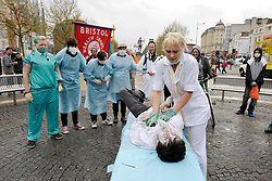 "© Licensed to London News Pictures. 07/04/2012. Bristol, UK. A street theatre protest in Bristol City Centre campaigning to save the NHS, part of the Facebook group ""Save our NHS - Bristol"" and the Bristol and District Anti-Cuts Alliance. .Photo credit : Simon Chapman/LNP"