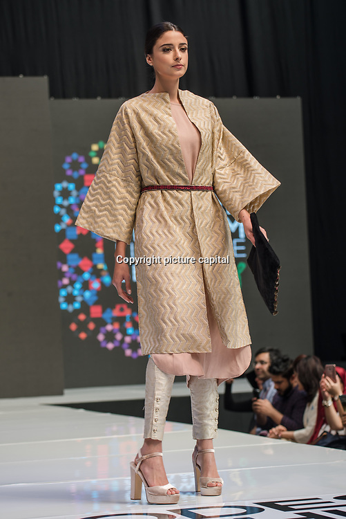 Olympia London, UK. 21 April 2018: Designer showcases it latest design at the Modest Fashion Show at  London Muslim Lifestyle Show 2018, London, UK.