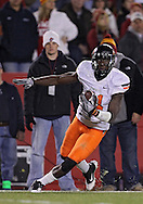 November 18, 2011: Oklahoma State Cowboys wide receiver Justin Blackmon (81) runs after a catch for a 27 yard touchdown during the first half of the NCAA football game between the Oklahoma State Cowboys and the Iowa State Cyclones at Jack Trice Stadium in Ames, Iowa on Friday, November 18, 2011. At halftime Oklahoma State was leading Iowa State 17-7.