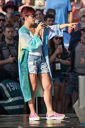 Image ©Licensed to i-Images Picture Agency . 18/07/2014 . Henham Park , Suffolk , United Kingdom . Pop star LILY ALLEN making an unannounced appearance for television's the Andrew Marr Show , on The Waterfront Stage . The Latitude Festival of music and arts . Picture by Joel Goodman/i-Images