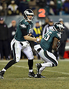 Philadelphia Eagles running back LeSean McCoy (25) takes a handoff from Philadelphia Eagles quarterback Nick Foles (9) during the NFL NFC Wild Card football game against the New Orleans Saints on Saturday, Jan. 4, 2014 in Philadelphia. The Saints won the game 26-24. ©Paul Anthony Spinelli