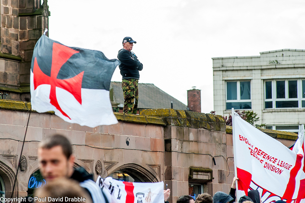 EDL members and supporters in All Saints Square near Rotherham Minster during Saturdays  EDL rally in South Yorkshire  in Rotherham Town Centre <br /> <br /> May 10 2014<br /> Image &copy; Paul David Drabble <br /> www.pauldaviddrabble.co.uk