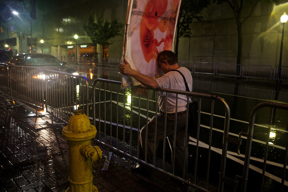 A pro-life supporter holds a sign in the streets and the rain during the 2012 Democratic National Convention on Tuesday, September 4, 2012 in Charlotte, NC.