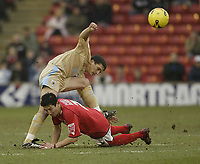 Photo: Aidan Ellis.<br /> Barnsley v Bristol City. Coca Cola League 1. 04/02/2006.<br /> Barnsley's Jacob burns challenges Bristol'sCole Skuse