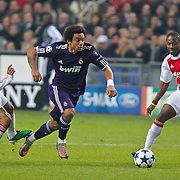 NLD/Amsterdam/20101123 - Ajax - Real Madrid, Marcelo (12) / Eyong Enoh (6) / Urby Emanuelson (11)