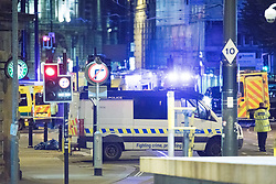 © Licensed to London News Pictures. 23/05/2017. Manchester, UK. Police and other emergency services are seen near the Manchester Arena after reports of an explosion. Police have confirmed they are responding to an incident during an Ariana Grande concert at the venue. Photo credit: Joel Goodman/LNP