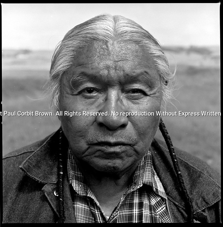 "Joseph Flying By (1917-2000), a Lakota medicine man, on Rattlesnake Butte, SD. His Lakota name is Kangi Ho Tanka, which means ""Crow with a Loud Voice."""