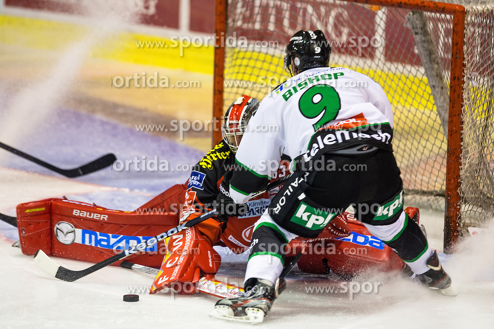 Hunter Bishop (HDD Telemach Olimpija, #9) vs Pekka Tuokkola (EC KAC, #83) during ice-hockey match between EC KAC and HDD Telemach Olimpija in 1st Round of EBEL League in Season 2014 / 15 on September 12, 2014 in Sporthalle KAC, Klagenfurt, Slovenia. Photo by Matic Klansek Velej / Sportida