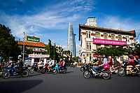 Late afternoon traffic in downtown Ho Chi Minh City, Vietnam, with the Bitexco Tower in the background.
