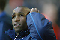 1/1/2005 - FA Barclays Premiership - Tottenham Hotspur v Everton - White Hart Lane<br />Tottenham Hotspur striker Jermain Defoe scratches his head on the sidelines before the match, a match he missed thorugh injury.<br />Photo:Jed Leicester/Back Page Images